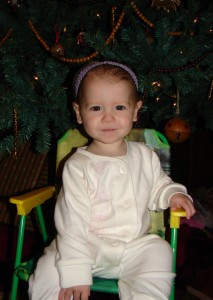 My daughter with our Christmas Tree